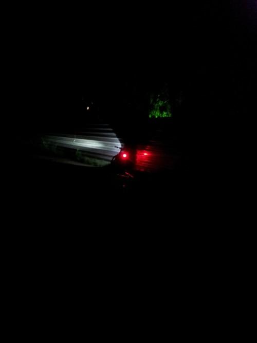 Метров с десяти с включенными светодиодами и фонарем
